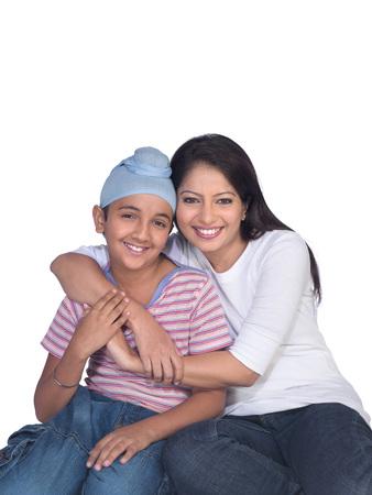 Sikh lady hugging son