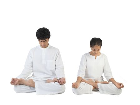 Boy and girl in meditation posture