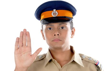 Police inspector showing hand palm to stop 版權商用圖片