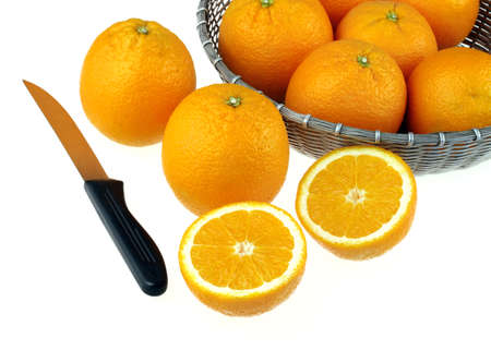 Full oranges and two cut pieces with knife citrus reticulata clementin rutaceae,India Stock Photo