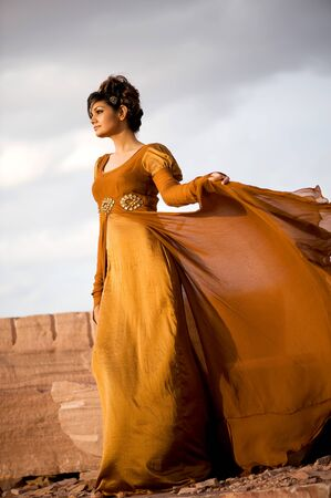 Woman standing in brown gown,India