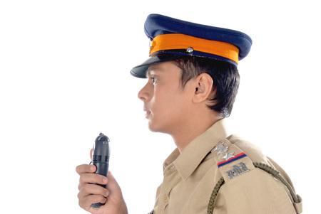Police inspector using walky talky 版權商用圖片