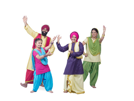Sikh family performing folk dance bhangra