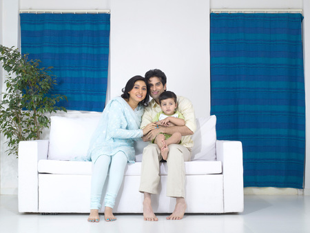 family sofa: Couple with their baby