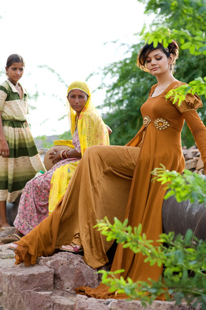 Woman sitting in brown gown,India