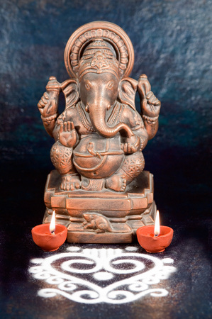 lords: Sculpture of ganesh with oil lamp,India LANG_EVOIMAGES