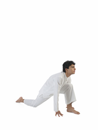 Boy practicing vanar asana