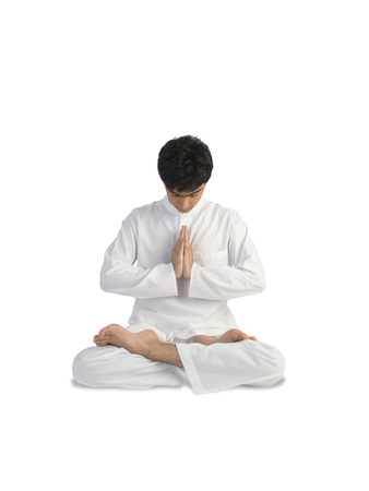 Boy in meditation posture Stock Photo