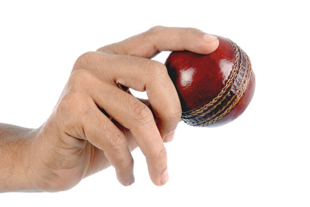 Cricketer thronging red ball