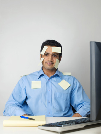 Executive covered with sticky notes
