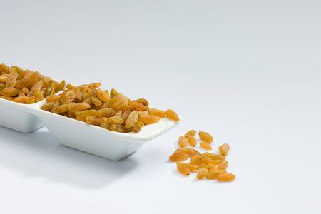 Dry fruits kismiss in bowls Stock fotó