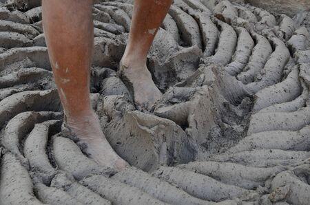 Legs of potter crushing soil at Jodhpur Rajasthan India