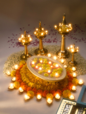 Diyas oil lamps and flowers arrangement for diwali festival ; India