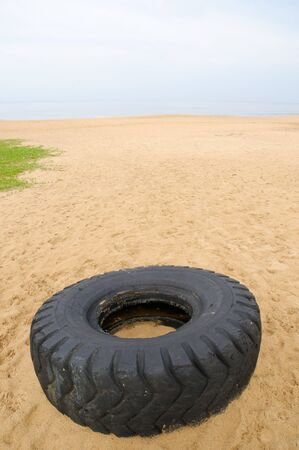 The big tyre lying on the sands of Calangute Beach Goa Maharashtra India Asia September 2010 Stock Photo