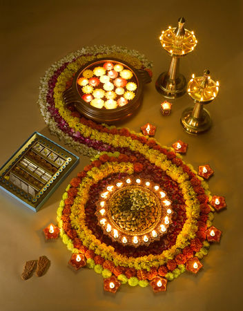 Diyas oil lamps sweets and flowers arrangement for diwali festival ; India Stockfoto