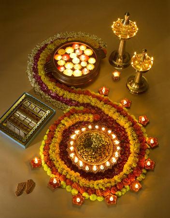 Diyas oil lamps sweets and flowers arrangement for diwali festival ; India Foto de archivo