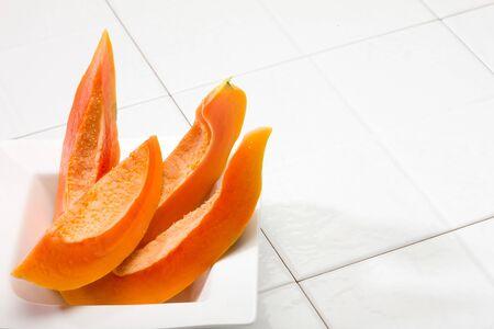 Papaya slice in bowl