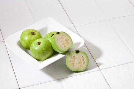 Guava in bowl Stock fotó