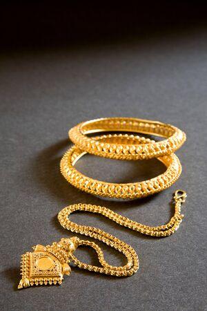 Gold necklace with locket and kangan bangle india april 2011 Reklamní fotografie