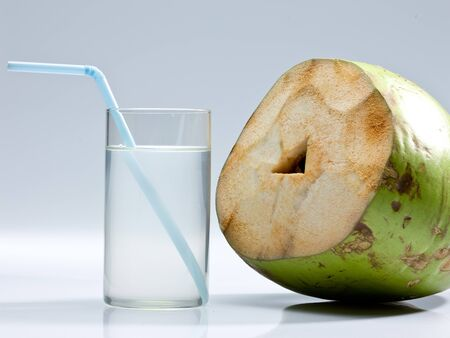 Coconut with coconut water glass Stock fotó