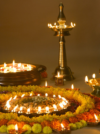 Diyas oil lamps and flowers arrangement for diwali festival ; India