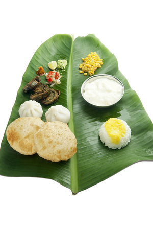 Maharashtrian food served on banana leaves India