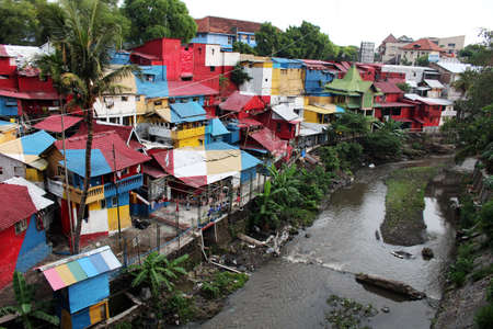 blighted: YOGYAKARTAINDONESIA - NOVEMBER 2015: View of one of one of the poorest, but completely colorful, neigborhoods north of the touristic Malioboro Street