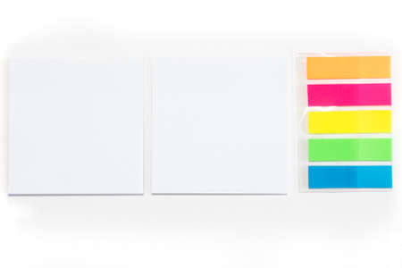 Two White sticky note and different colored sheets of note papers isolated on white background.