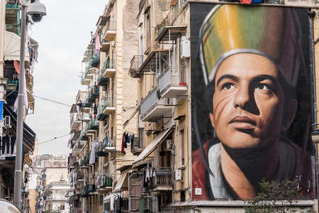 Decorated Building in Forcella district in the historic center Naples with Saint Gennaro face. Saint Gennaro is the patron of the city of Naples, Italy. High quality photo