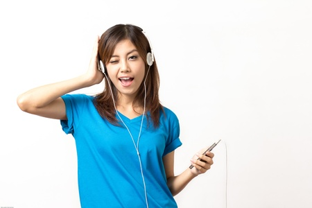 woman listening to music by headphones