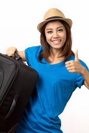 woman carrying Luggage photo