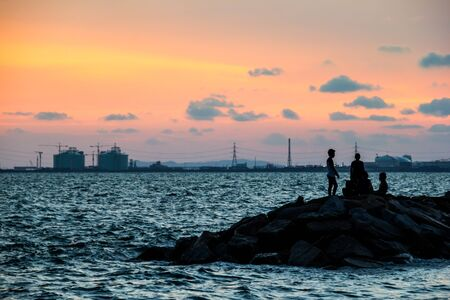industrialised: The factory near the coast with Children Stock Photo