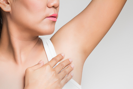 underarms: woman holding her arms up and showing underarms