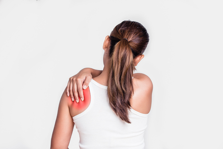 soreness: Asian woman with shoulder pain Stock Photo