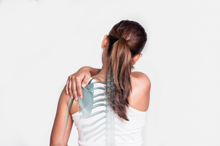 soreness: Asian woman with shoulder pain and see the bone.