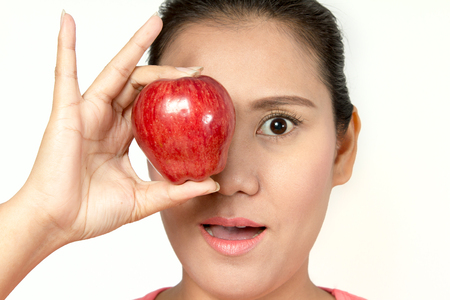 chomp: asian woman holding red apple in her hands