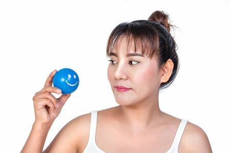relent: asian woman with smiley face stress ball