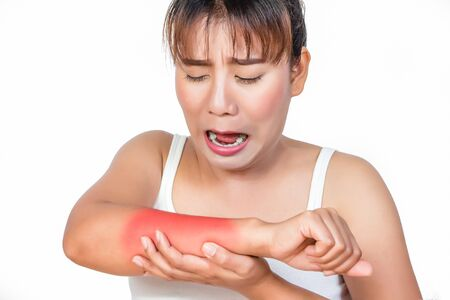 Asian woman having arm pain