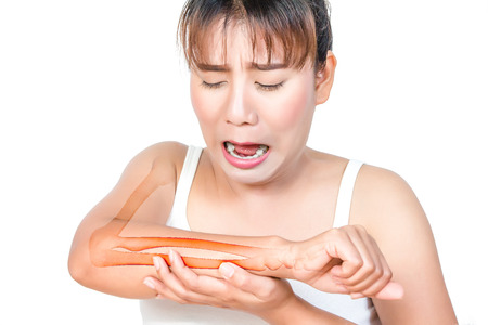 misadventure: Asian woman having arm pain and see the bone.