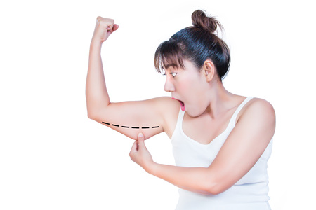 agape: asian woman checking her upper arm and she agape
