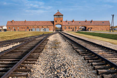 nazism: Oswiecim, Poland - October 28, 2007: The entrance of the notorious Auschwitz II-Birkenau, a former Nazi extermination camp and now a museum  Editorial