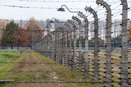Oswiecim, Poland - October 28, 2007: Barbed wire fences in Auschwitz II-Birkenau, a former Nazi extermination camp and now a museum