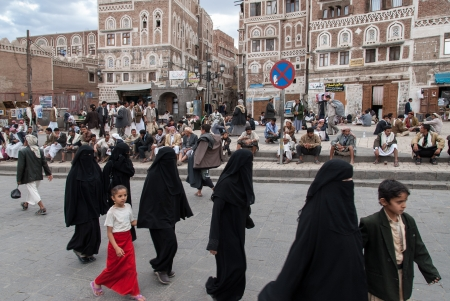 Sanaa, Yemen - May 4, 2008: A group of unidentified women cross the main square of the city. Among other arabic countries, in 2012 Yemen became a site of civil conflicts.