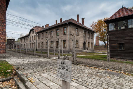 Oswiecim, Poland - October 28, 2007: Several buildings, separated by barbed wire in Auschwitz museum site