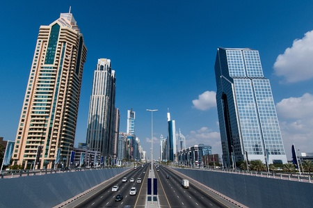 Dubai, UAE - January 1, 2005: Some of its famous skyscrapers, as shown from a bridge near the town center