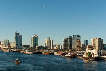 mid afternoon: Skyline of Dubai near Dubai Creek Stock Photo