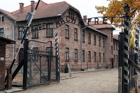macht: Oswiecim, Poland - October 28, 2007: The entrance of the  Auschwitz-Birkenau State Museum. The museum performs several tasks, among them research into the Holocaust.