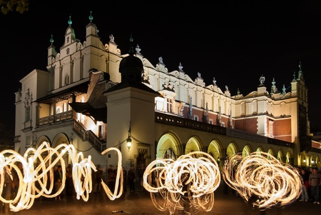 Krakow, Poland - October 27, 2006: A group of jugglers present a fire show near the Cloth Hall at the Main Market Square Stock Photo - 17298362