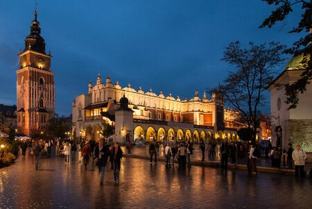 Krakows Main Market Square, one of the biggest squares in Europe, featuring the Town Hall Tower and the Cloth Hall on October 24, 2006 in Krakow, Poland