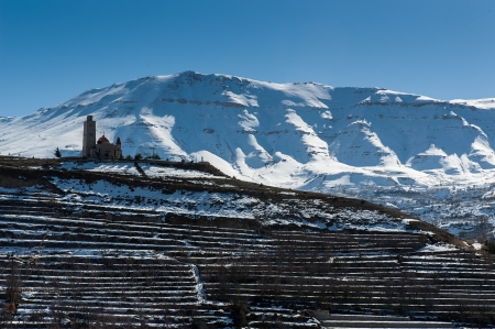 Old church on snowy mountains of Lebanon Stock Photo